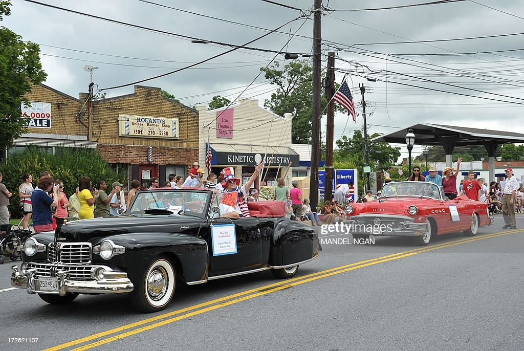 Vintage cars take part in the Independence Day parade in Takoma Park Maryland on July 4 2013 Independence Day celebrates the declaration of...