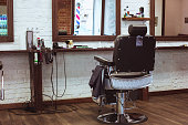 Vintage chair and interior in stilish barbershop