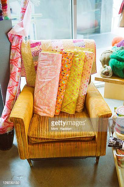 Vintage Chair in Craft Store with Bolts of Fabric