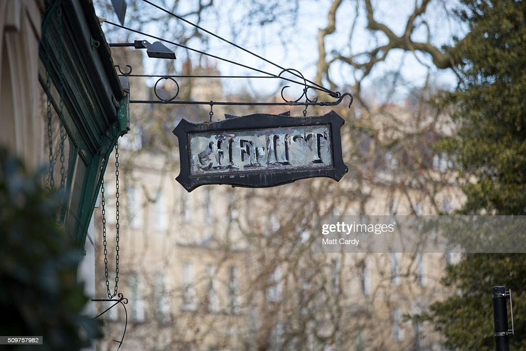 A vintage chemis sign is displayed outside a independent chemist shop on February 12, 2016 in Bath, England. One in four high street pharmacies could close as the Government cuts £170 million from the prescription handling fees paid to them.