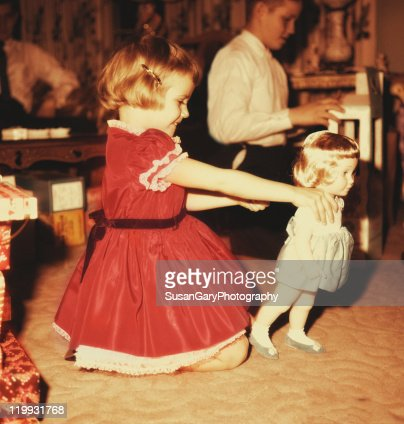 Vintage christmas girl with doll : Stock Photo