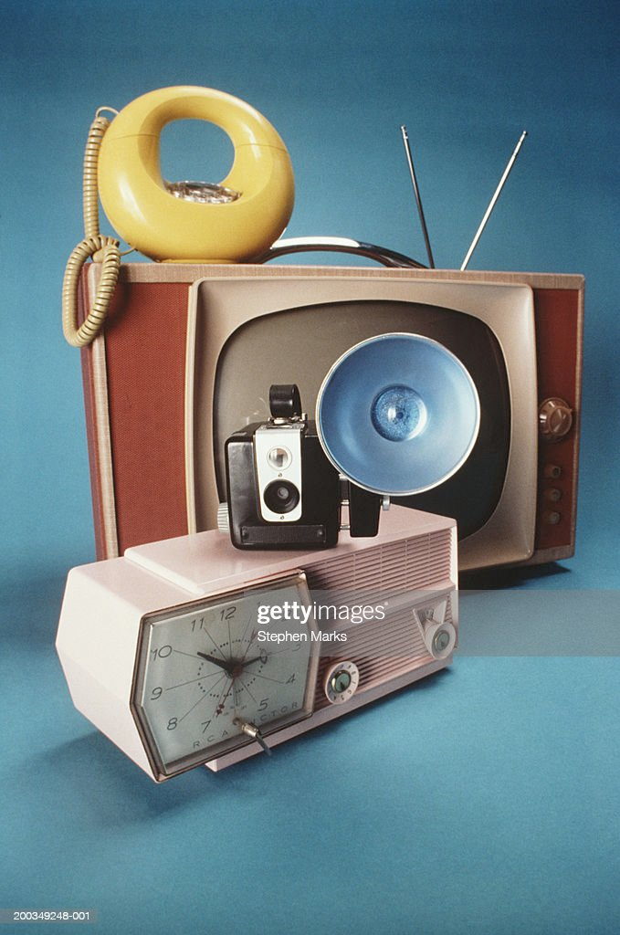 Vintage clock, camera, telephone and television of 1950's and 1960's : Stock Photo