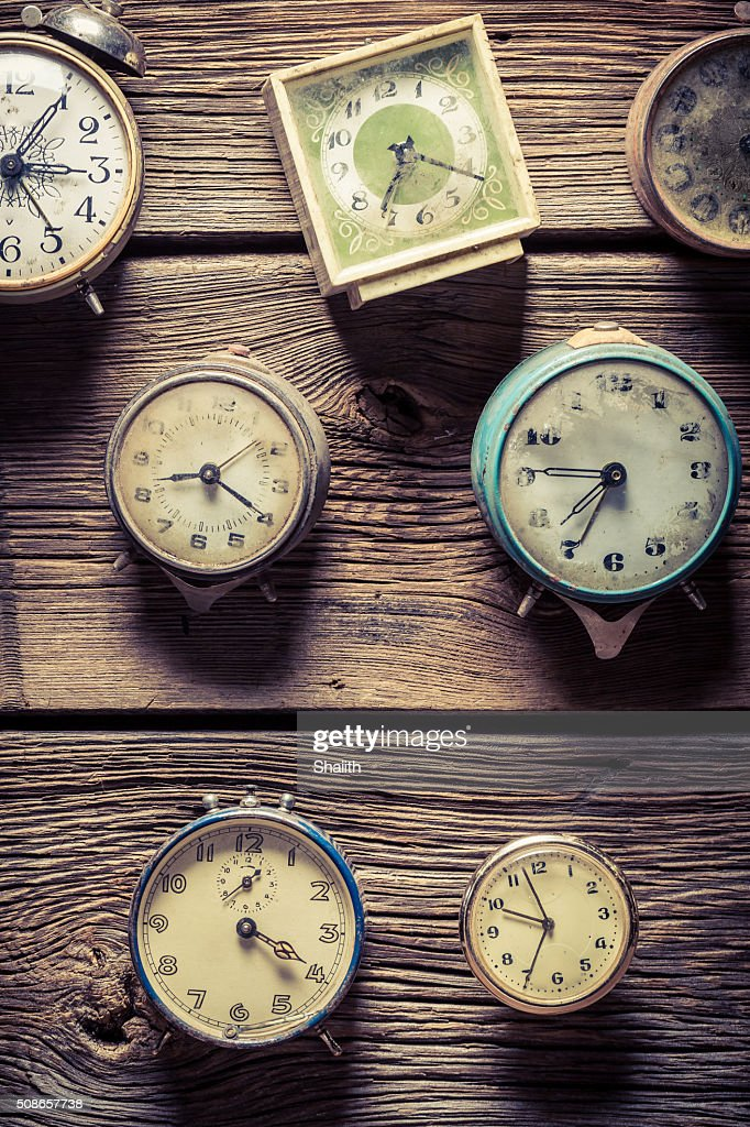 Vintage clocks on the wooden wall : Stock Photo