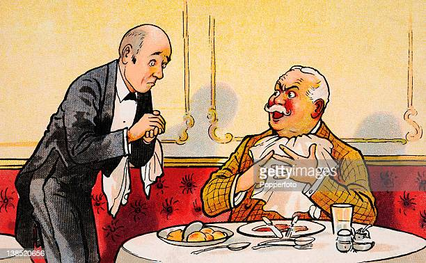 A vintage colour illustration depicting an angry customer complaining about his meal to a waiter in a restaurant circa 1910