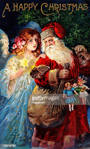 A vintage colour illustration of Santa Claus or Father Christmas holding a Christmas tree and a sack dolls and a clown next to an angel holding a...