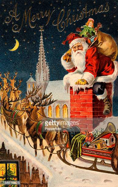 A vintage colour illustration of Santa Claus or Father Christmas climbing down a chimney with a large sack of toys including a doll and a toy train...