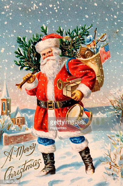 A vintage colour illustration of Santa Claus or Father Christmas trudging through the snow holding a trumpet and a drum and a bulging sack of toys...