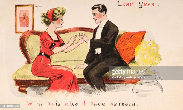 A vintage colour postcard celebrating Leap Year illustrating a woman proposing marriage to a man with the message 'With this ring I thee betroth'...