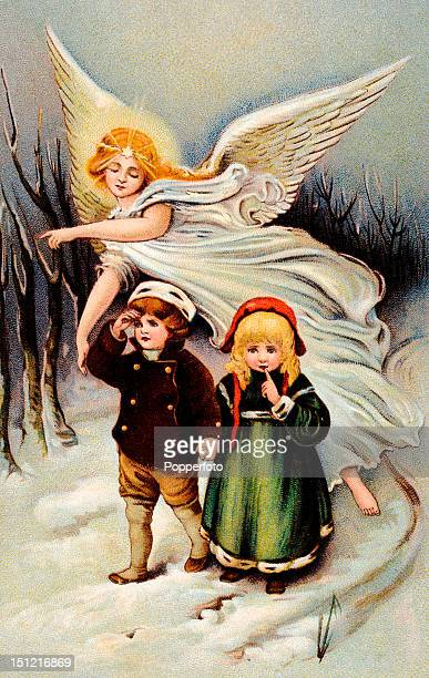Vintage colour postcard illustrating a guardian angel helping two little lost children find their way out of the forest circa 1910