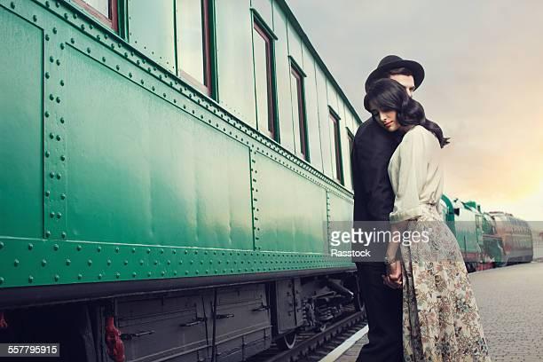 Vintage couple at railroad station