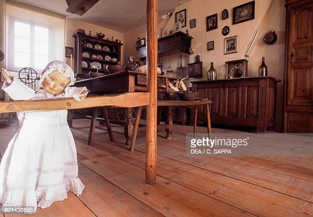 Vintage doll in a room with period furniture Castle of Champlitte now the Popular arts and traditions museum FrancheComte France 18th century