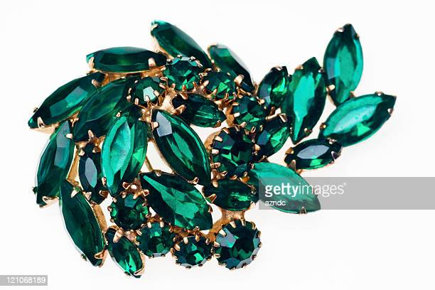 Vintage emerald green brooch isolated on a white background