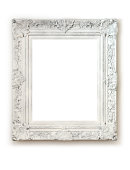 Vintage empty frame isolated on white wall.