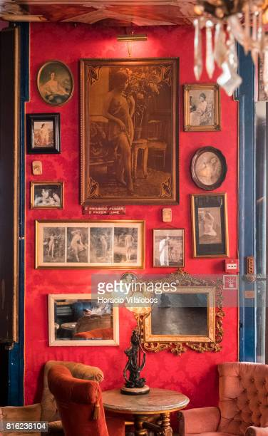 Vintage erotic photographs reproducing typical brothel decoration at 'Pensao Amor' on July 14 2017 in Lisbon Portugal 'Pensao Amor' used to be a five...
