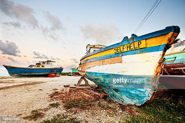 Vintage faded fishing boats on land