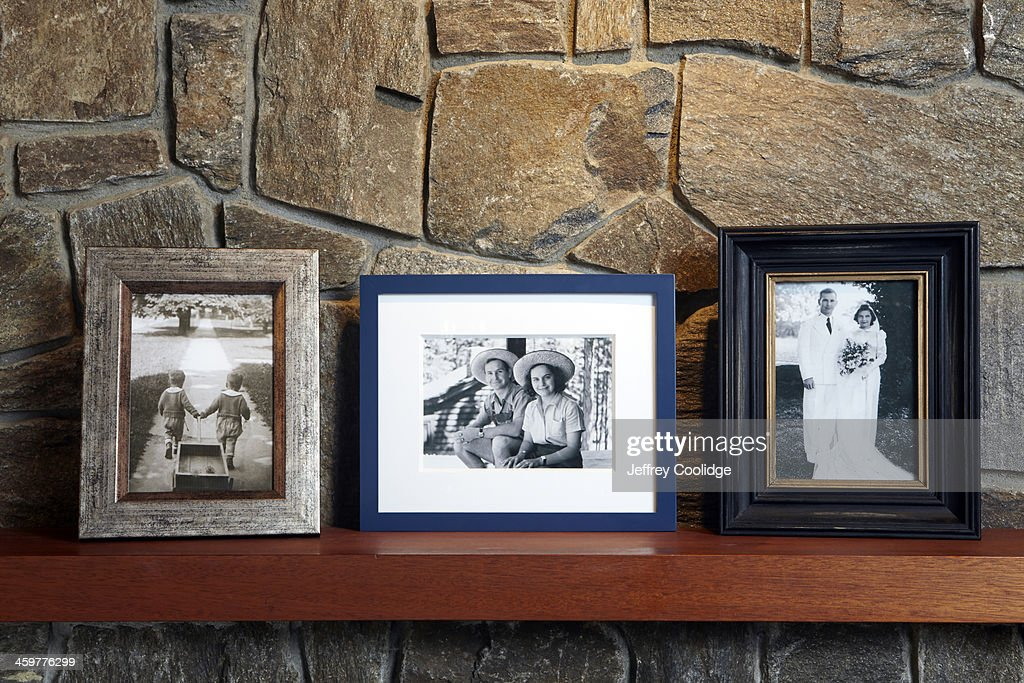 Vintage Family Photos on Mantle : Stock Photo
