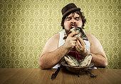 vintage fat man eating fish head soup at wood table