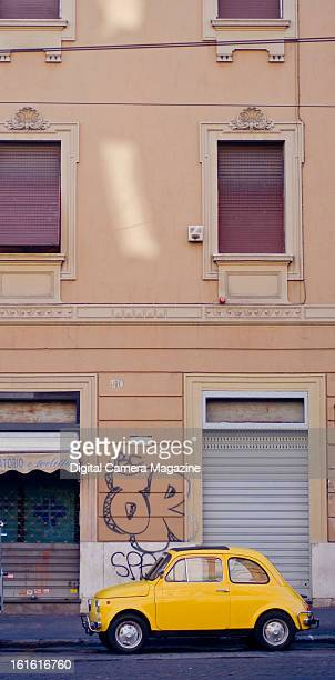 A vintage Fiat 500 parked beneath an apartment block in Rome taken on May 15 2012