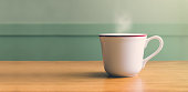 Vintage filter,Hot white coffee cup on wood table with blur pastel green wall with sun light from right side,Leave copy space for adding your text or design.