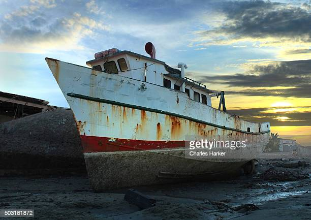 Vintage Fishing Boat at Low Tide at Sunset