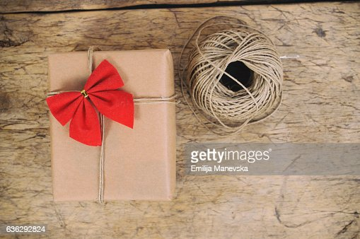 Vintage gift box rapped in red ribbon