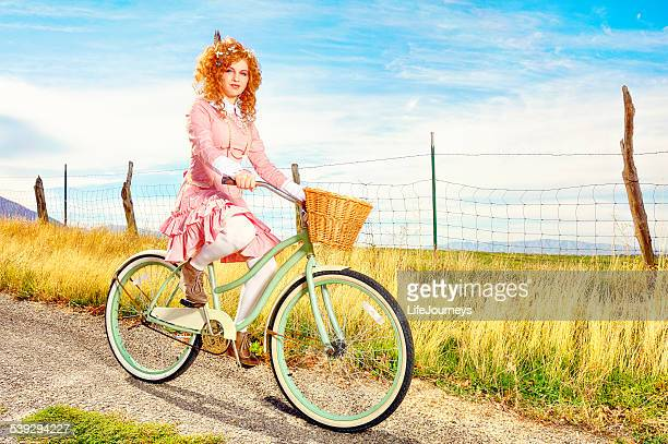 Vintage Girl Riding Her Bicycle In The Countryside