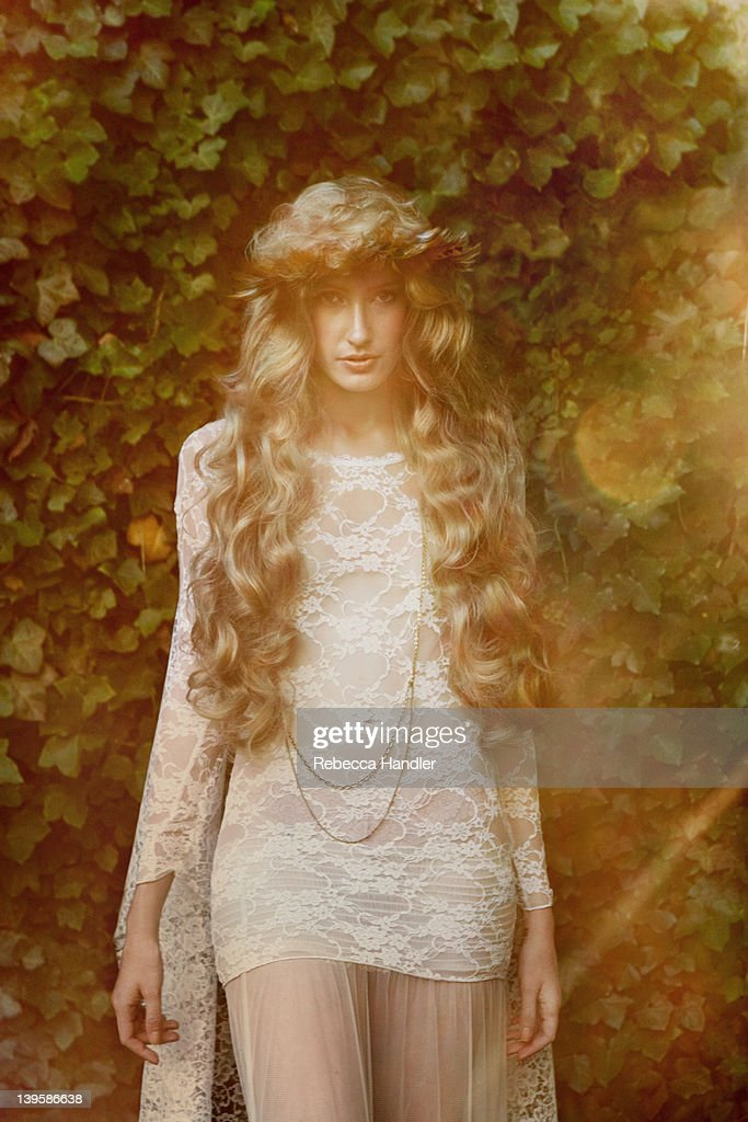 Vintage girl standing in garden : Stock Photo