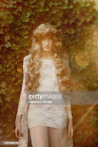 Vintage girl standing in garden : Stock Photo