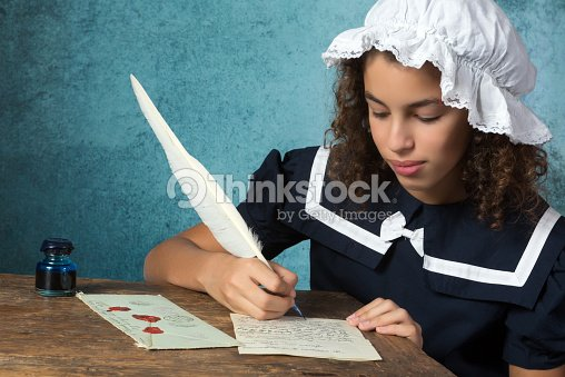 vintage girl writing a letter stock photo thinkstock
