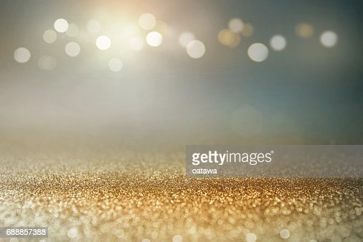 Vintage glitter gold, dark blue and black lights bokeh background. : Stock Photo