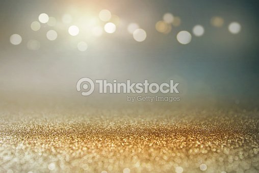 Vintage glitter gold, dark blue and black lights bokeh background. : Stock Photo