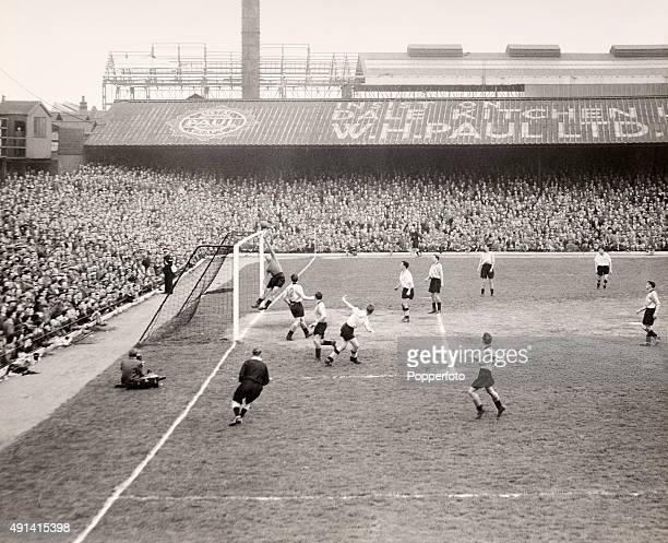 Vintage goalmouth action during a Division One match between Derby County and Wolverhampton Wanderers with Bert Williams in goal for the Wolves at...