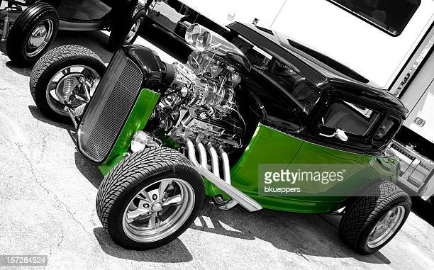 Vintage green and black car without a hood