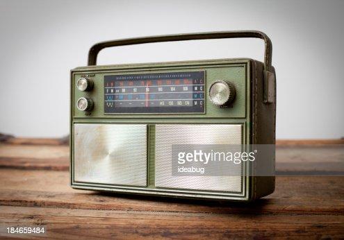 Vintage Green Portable Radio Sitting on Wood Table