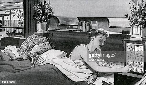 Vintage illustration of a couple in bed adjusting their futuristic home automation system screen print 1955
