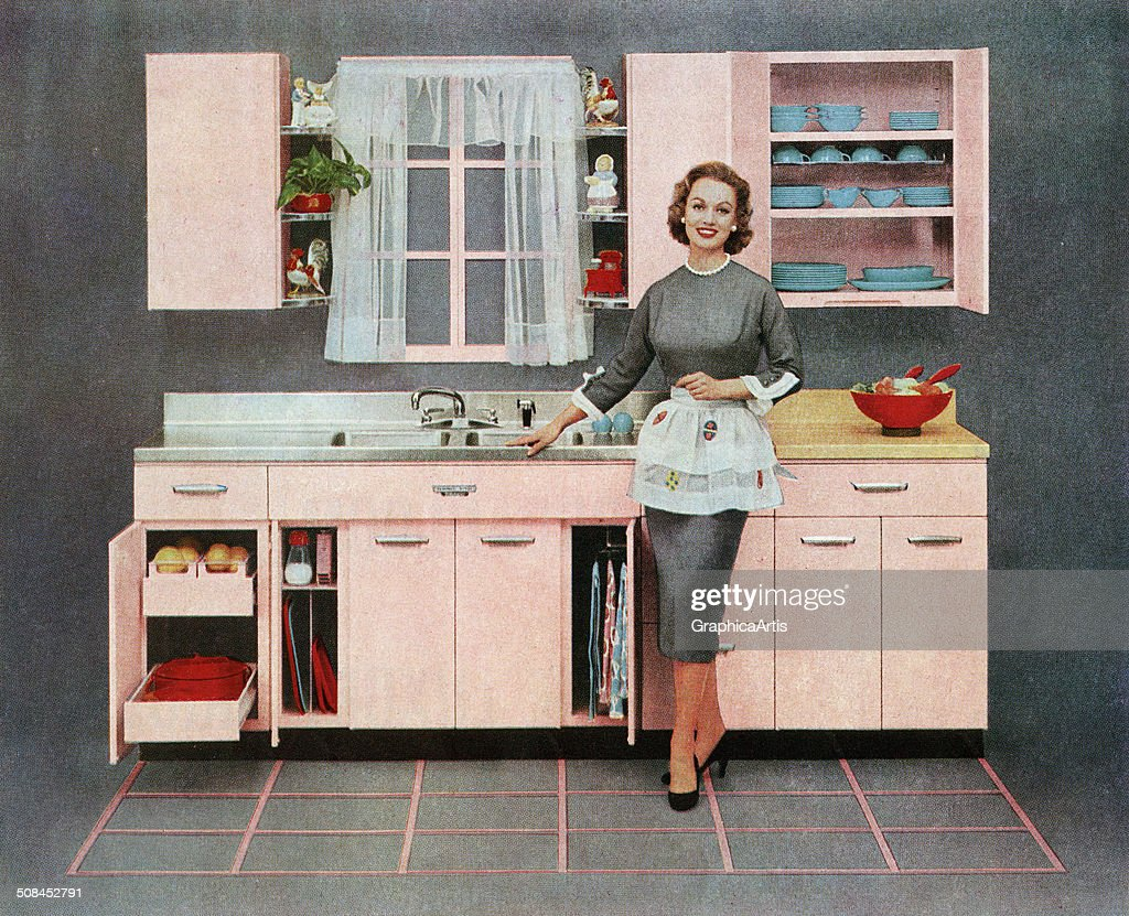 Vintage illustration of a fashionable housewife standing in front of her new pink kitchen, 1957. Screen print.
