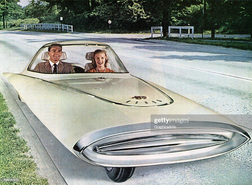 Vintage illustration of a futuristic 3-wheeled self-driving 'dream car,' 1961.