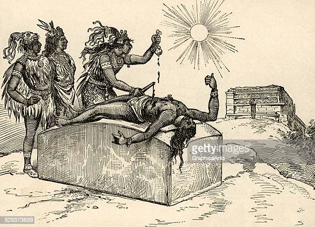 Vintage illustration of an Aztec priest removing the heart of a victim as a sacrifice to the gods engraving 1889