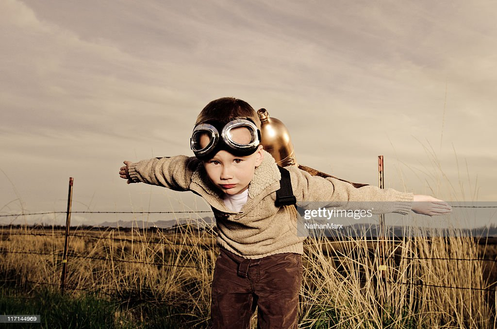 Vintage image of a child wearing jet pack flying : Stock Photo