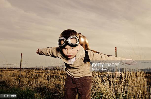 Vintage image of a child wearing jet pack flying