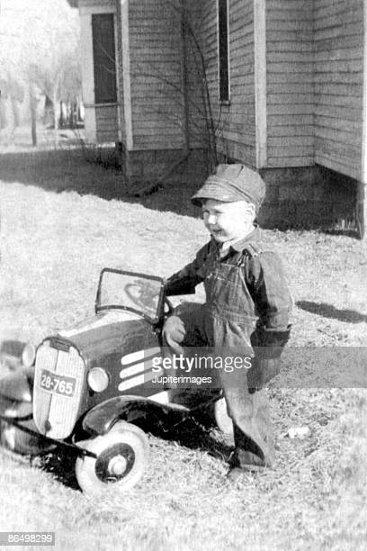 Vintage image of boy with toy tractor