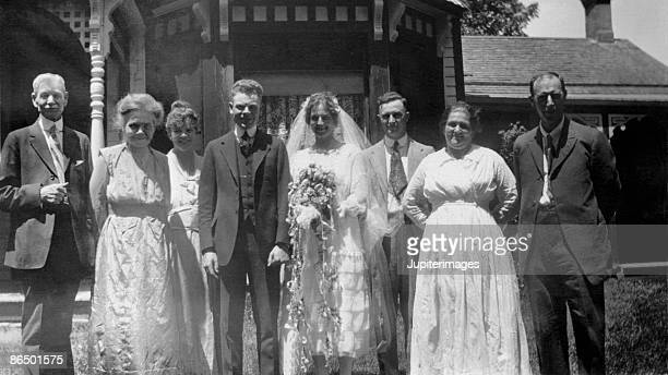 Vintage image of bride and groom with family