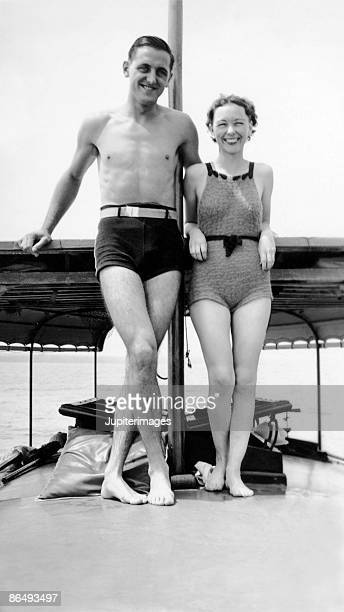 Vintage image of couple wearing swimsuits on boat deck