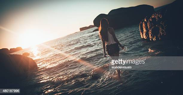 Vintage image of girl at the beach at sundown