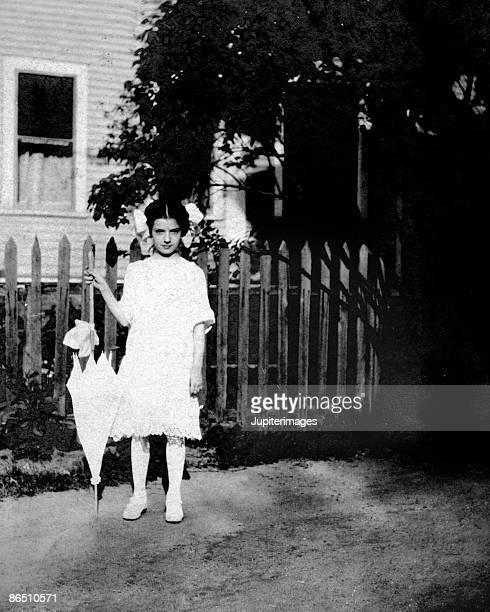 Vintage image of girl holding parasol