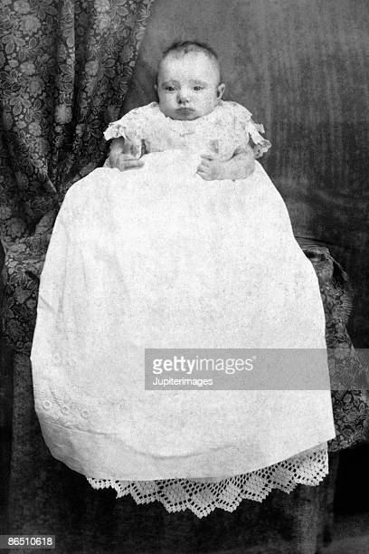 Vintage image of infant in christening gown