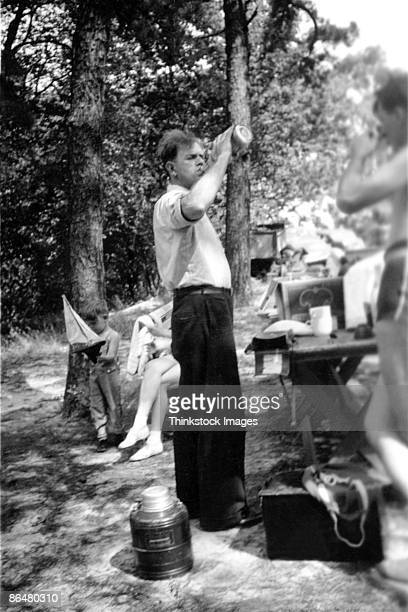 Vintage image of man drinking at picnic