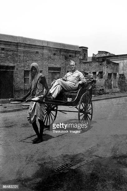 Vintage image of man pulling soldier in rickshaw