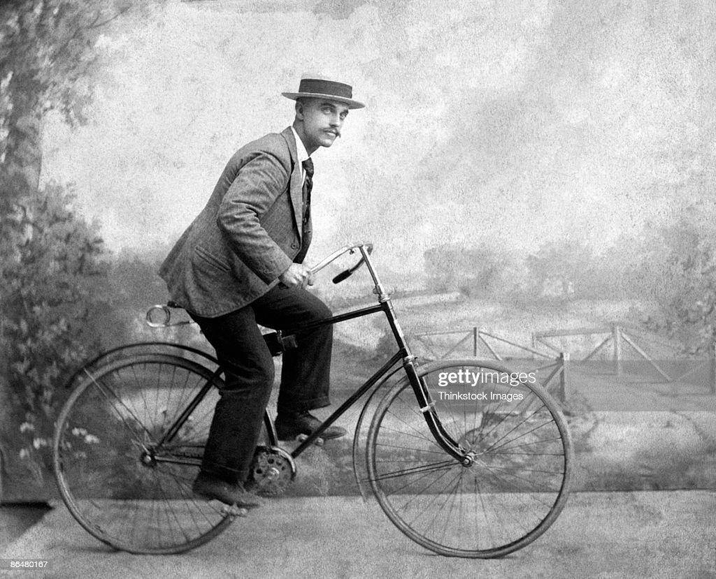 Vintage image of man riding bicycle