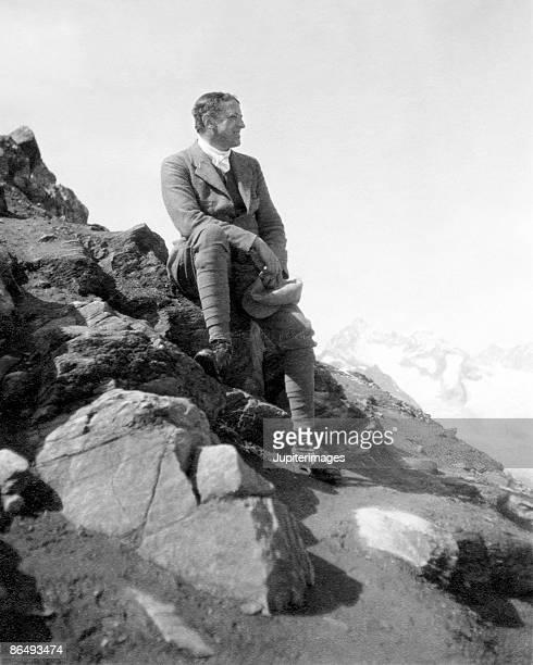 Vintage image of man sitting on rocks